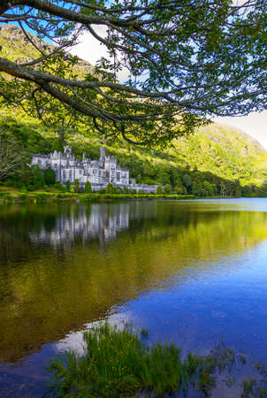 connemara: Calway, Ireland - August 4, 2013: Connemara area, the Kylemore abbey on the Pollacappul lake