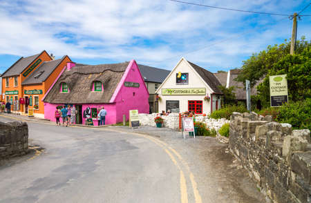 doolin: Calway, Ireland - August 4, 2013: Tourists between the  colored houses of the Doolin village Editorial