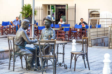 gamers: Toulon, France - June 27, 2009:  Raimu square, The card gamers sculpture of Marcel Pagnol. Editorial