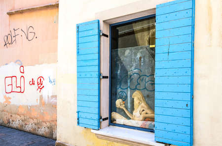 toulon: Toulon, France - June 27, 2009: A surreal art work on a window of the old country center. Editorial