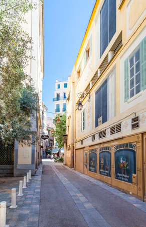 toulon: Toulon, France - June 27, 2009: An alley  of the old country center with decorated windows of an art store on the right. Editorial