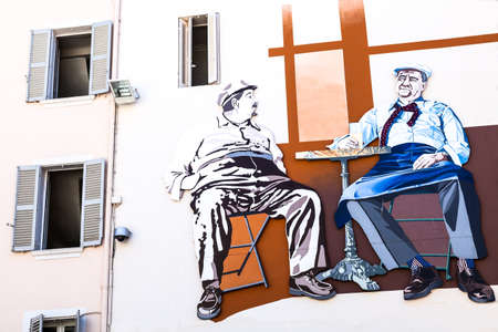wall mural: Toulon, France - June 27, 2009: Marius and Cesar a mural painting of Marcel Pagnol, on a wall of the old city.