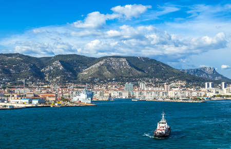 toulon: Toulon, France - June 27, 2009: The harbor with the city on the background seen from the sea. Editorial