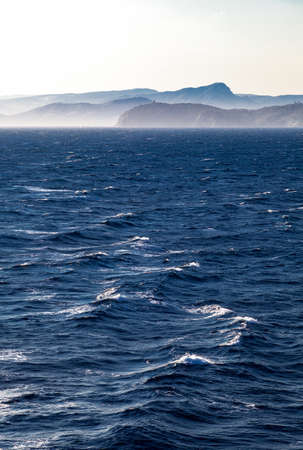 toulon: France, the misty Toulon coast seen from a rough open sea.