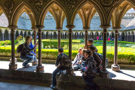 st  michel: Mont St. Michel, France - May 22, 2012: Normandy, tourists taking pictures in the cloister of the abbey.