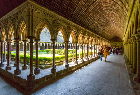st michel: Mont St. Michel, France - May 22, 2012: Normandy, tourists in the cloister of the abbey. Editorial