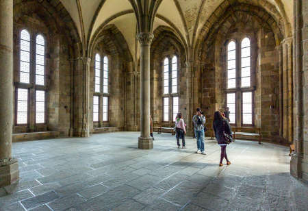 st michel: Mont St. Michel, France - May 22, 2012: Normandy, tourists in the reception hall of the abbey.