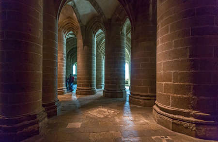 crypt: Mont St. Michel, France - May 22, 2012: Normandy, tourists in  the crypt of the abbey. Editorial