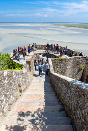 michel: Mont St. Michel, France - May 22, 2012: Normandy, tourists in the lookuot of the medieval village .
