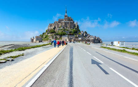 michel: Mont St. Michel, France - May 22, 2012: Normandy, tourists returning from the visit to the village and abbey. Editorial