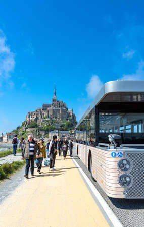 st  michel: Mont St. Michel, France - May 22, 2012: Normandy, tourists returning from the visit to the village and abbey. Editorial