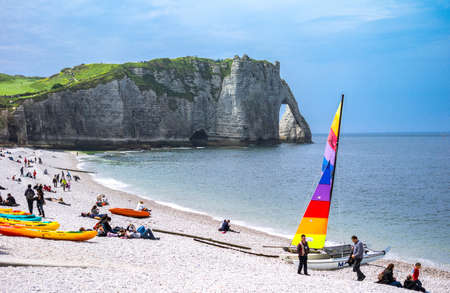 normandy: Etretat, France - May 19, 2012: Normandy, local people relaxing on the beach near the cliffs . Editorial