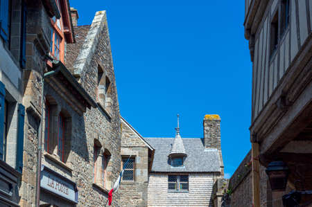 st  michel: France, Normandy, houses and post office of the medieval village of Mont St Michel. Stock Photo