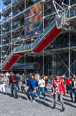 croud: Paris,  France - October 3, 2009: Young people dancing in front of the Pompidou Cultural Center Editorial