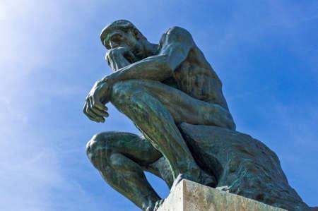 rodin: Paris,  France - August 31, 2011:  Le Penseur sculptures of August Rodi in the Rodin Museum garden.
