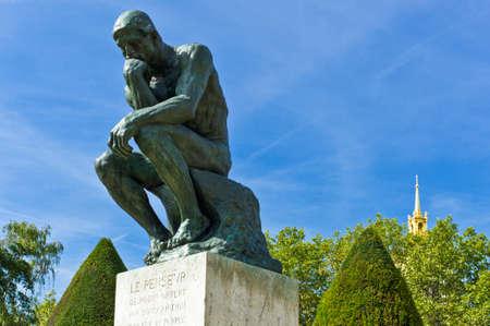 Paris,  France - August 31, 2011:  'Le Penseur' sculptures of August Rodi in the Rodin Museum garden.