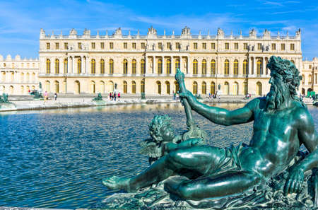 Royal Palace: Paris,  France - August 31, 2011: A statue and the pool of the Royal Palace of Versailles.