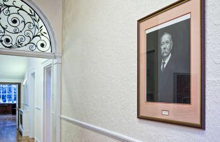 London, England - January 27, 2012: A Sir Arthur Conan Doyle photographic portrait in a building of Wimpole street