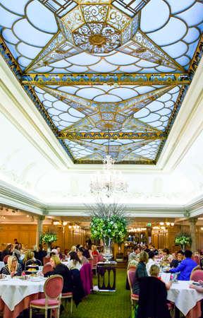 harrods: London, England - January 27, 2012:  The afternoon tea hall of the Harrods Georgian restaurant Editorial