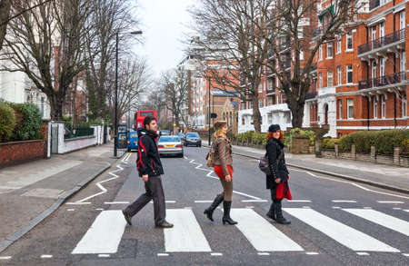 London, England - January 31, 2012: People crossing the street near the Abbey road Studios