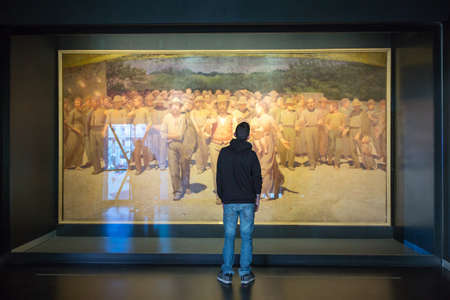 twentieth: Milan, Italy - April 12, 2012: A bot in front of The Fourth Estate painting of Pellizza da Volpedo, in the Museum of the twentieth century