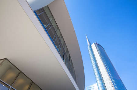 sinuous: Milan, Italy - January 24, 2015: Porta Nuova, the sinuous Porta Nuova  building with the Unicredit tower in the background
