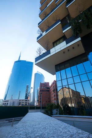 bosco: Milan, Italy - January 24, 2015: Porta Nuova, the Bosco Verticale towers with the Unicredit tower in the background