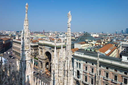 Milan, Italy - April 21, 2011:  The  Duomo square and Vittorio Emanuele gallery seen from the rooftop of the Duomo cathedral Editorial