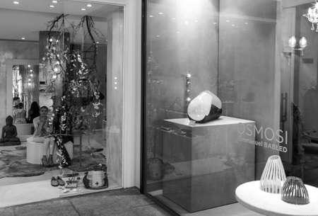 shopwindow: Milan, Italy - July 5, 2014: A woman in a shopwindow of  Montenapoleone street