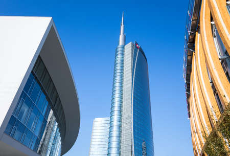 sinuous: Milan, Italy - February 9, 2015: Porta Nuova, the sinuous Porta Nuova  building with the Unicredit tower in the background