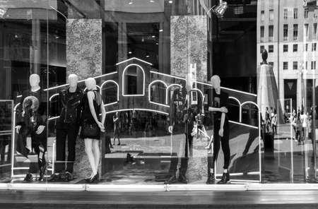shopwindow: Milan, Italy - July 5, 2014: Reflections on a shopwindow in San Babila square