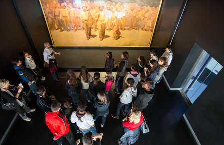 twentieth: Milan, Italy - April 12, 2012: Young people in front of The Fourth Estate painting of Pellizza da Volpedo, in the Museum of the twentieth century