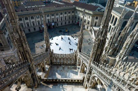 Milan, Italy - April 21, 2011:  The Royal Palace square seen from the Duomo cathedral rooftop Editorial