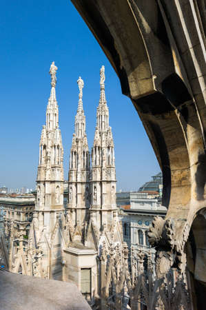 spires: Italy, Milan, spires and marle works of the Duomo cathedral rooftop Stock Photo