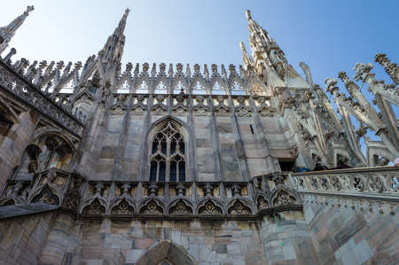 Italy, Milan, spires and marle works of the Duomo cathedral rooftop Stock Photo