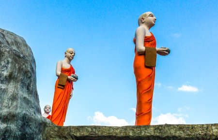 sri lanka temple: Danbulla, Sri Lanka - December 5, 2012: Monk statues of the Golden Temple