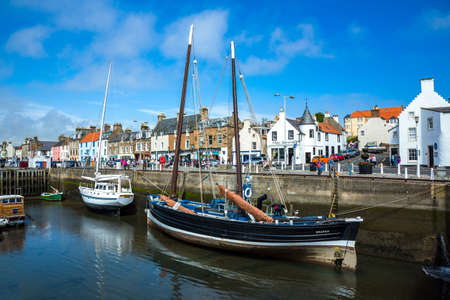 Anstruther, Scotland - July 26, 2012:  Fife area,  yachts in the village harbor at low tide. Editorial