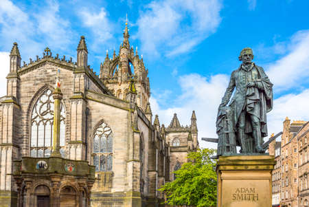 Great Britain, Scotland, Edinburgh, The Royal Mile, the apse of the St Giles Cathedral and the monument to Adam Smith.