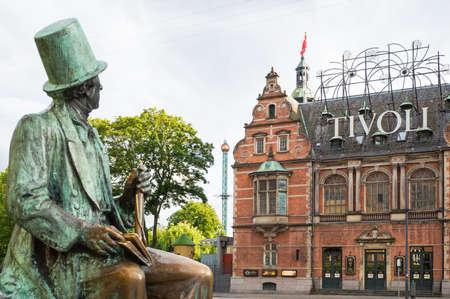 Copenhagen, Denmark - July 20, 2015: City Hall square, the Hans Christian Andersen statue looking toward the Tivoli park entrance