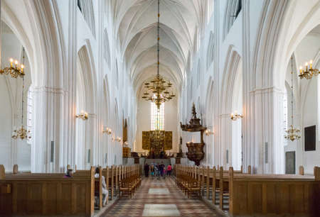 nave: Odense, Denmark - July 21, 2015: The nave of the gothic St. Canutes Cathedral