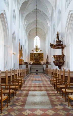 nave: Odense, the nave of the gothic St. Canutes Cathedral Editorial