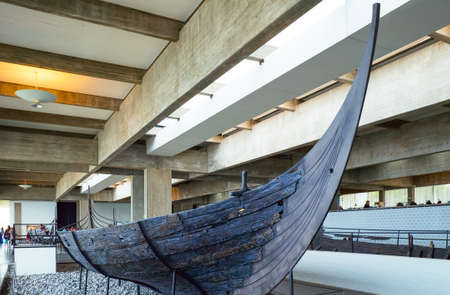 viking ship: Roskilde, Denmark - July 23, 2015: Visitors in the Viking Ship Museum