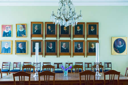 priests: Odense, Denmark - July 21, 2015: Portraits of the ancient priests in the sacristy the St. Canutes Cathedral