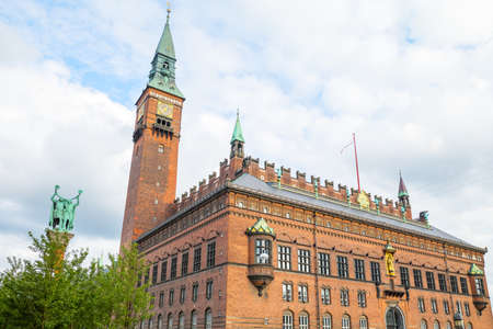 Copenhagen, the City Hall Palace with the Clock Tower and the Lur Blowers monument on the left
