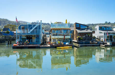 colorfully: Sausalito, USA - September 23, 2015: The colorfully painted House Boats in the outskirts of the country Editorial