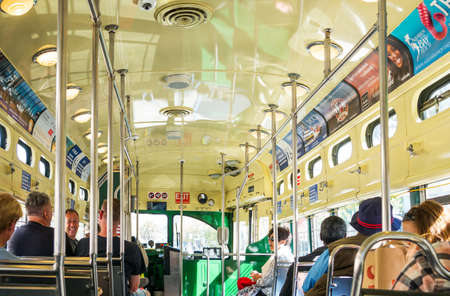 streetcar: San Francisco, USA - September 26, 2015: Tourists travelling in an historical streetcar