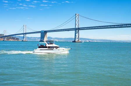 bay bridge: San Francisco, USA - September 26, 2015: The Bay Bridge seen from the Ferry Building pier