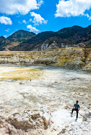 Nissyros, Greece - May 17, 2010: Tourists in the volcanos caldera
