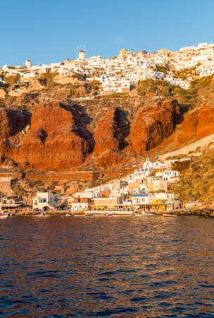 seaports: Greece, Santorini, the Oia village and its small seaport seen from the Caldera sea area at nightfall Stock Photo