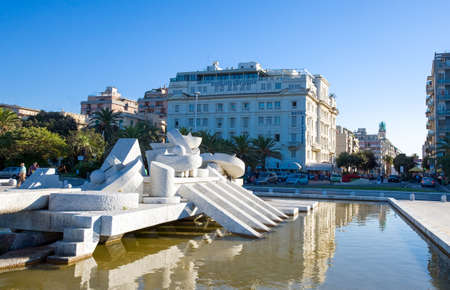 Pescara, Italy - September 4, 2006: The artwork La Nave by Pietro Cascella on the seafront with the city center in the background